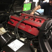 mechanic conducting maintenance on a car