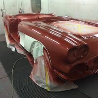 red corvette refinished in paint booth