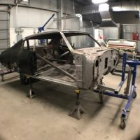 fully disassembled car on rotisserie